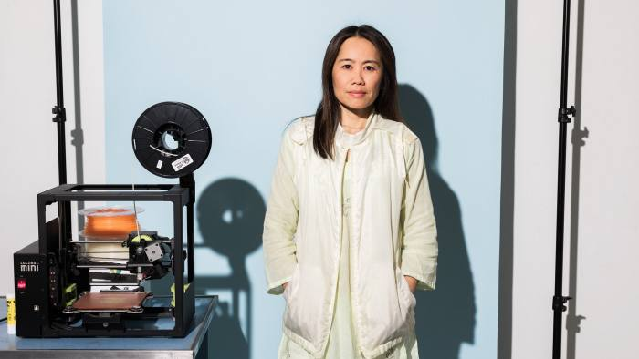 Artist Shirley Tse in her LA studio standing next to the 3D printer, a LulzBot Mini, used to create the artwork. Photo via Maggie Shannon.