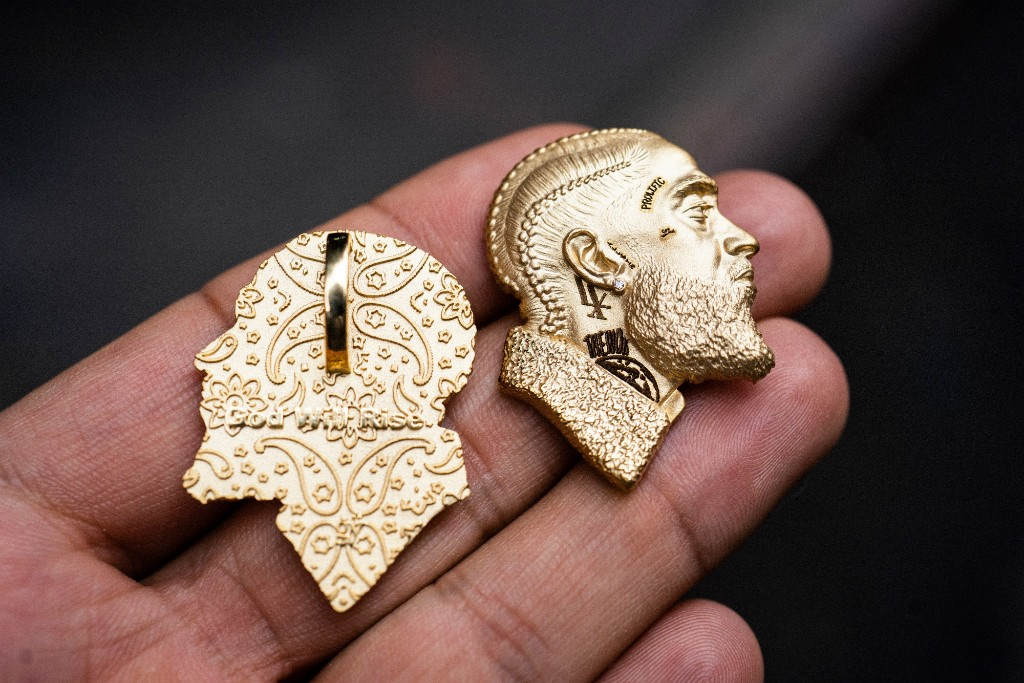 The 3D printed Nipsey Hussle pendant, giften to Lauren London by Charlamagne tha God. Image via Suresh Gordon.