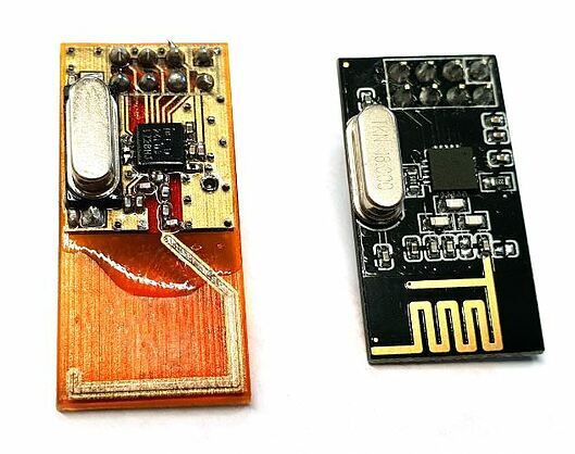 3D printed transceiver compared to a traditional transceiver. Photo via Nano Dimension.