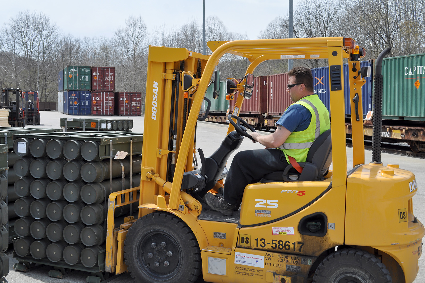 A forklift operator transports a pallet of ammunition at Crane Army Ammunition Activity (CAAA), Indiana, as part of the U.S. Army's supply chain. Photo via CAAA Public Affairs/U.S. Army