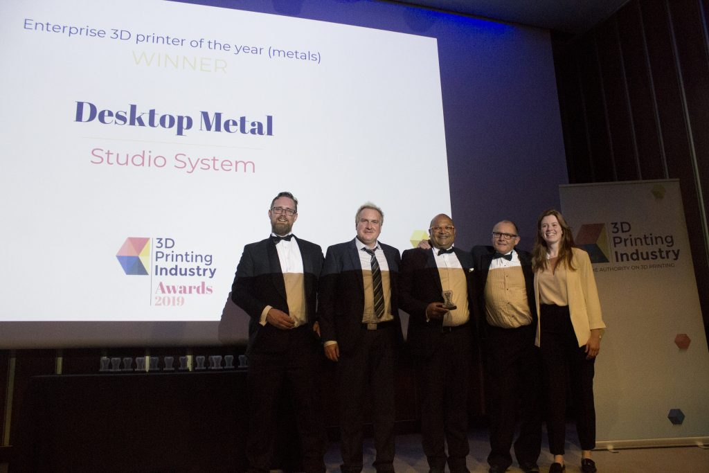 The Desktop Metal team take to the stage in acceptance of Enterprise 3D Printer of the Year (Metals) for the Studio System. Photo by 3D Printing Industry