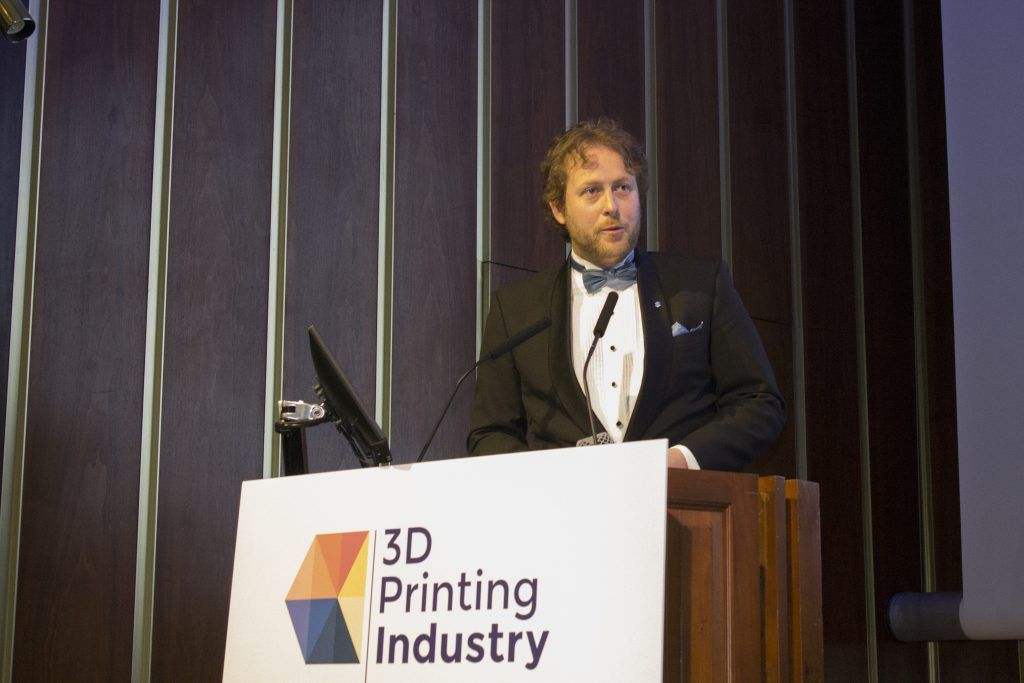 Justin Cunningham, Marketing Manager North East EMEA, Stratasys, accepts the award for 3019 Enterprise 3D Printer of the Year (Polymers) for the Stratasys J750. Photo by 3D Printing Industry
