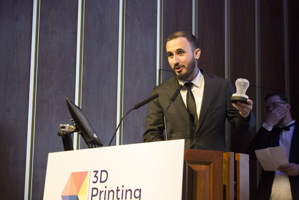 Xavier Martínez Faneca, Co-Founder and CEO of BCN3D Technologies, accepts the award for 2019 Medical, Dental or Healthcare Application of the Year. This year, the trophy was awarded for BCN3D's work with the University of Girona to create a 3D printed device used to isolate breast cancer cells. Photo by Felix Li for 3D Printing Industry
