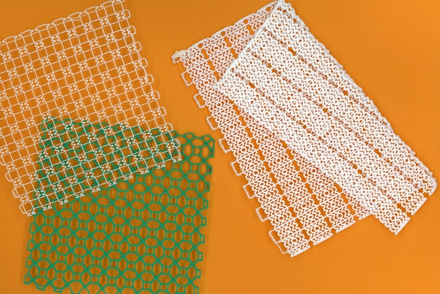 3D printed stretchy mesh, with customized patterns designed to be flexible yet strong, for use in ankle and knee braces. Photo via Felice Frankel/MIT.