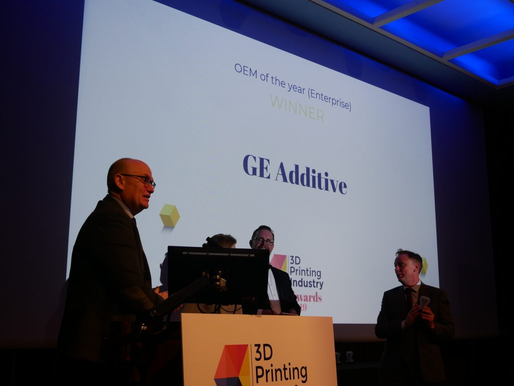 Shaun Wooton, PR & Media Relation Leader at GE Additive, accepting his company's award for OEM of the Year (Enterprise) Photo by 3D Printing Industry
