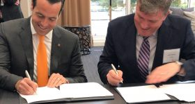 Brian Neff, CEO of Sintavia with David Preston, Howco Group's Executive Vice President, signing the term sheet