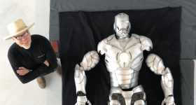 Adam Savage standing beside the assembled, 3D printed Iron Man suit. Photo via Adam Savage