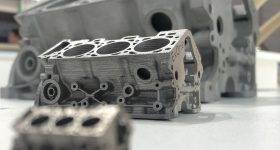 3D printed engine blocks on display at the GIFA show. Photo via ExOne.
