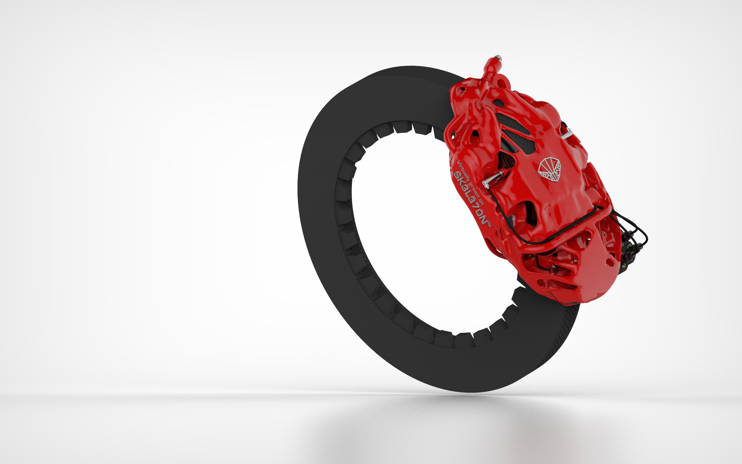 A 3D printed brake caliper created on the SK3L370N platform. Image via Carbon Performance.
