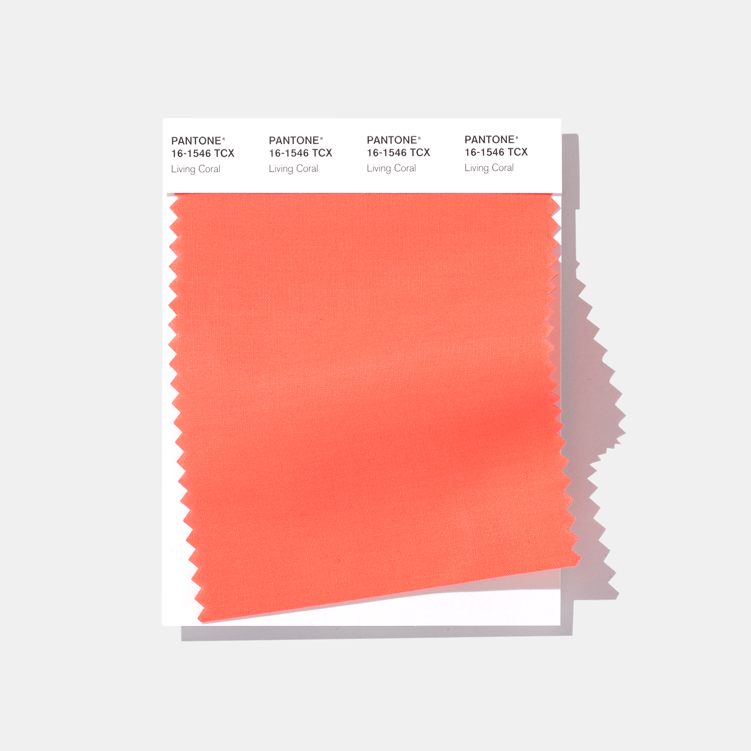 A cotton swatch of Pantone's color of the year, Living Coral. Image via Pantone.