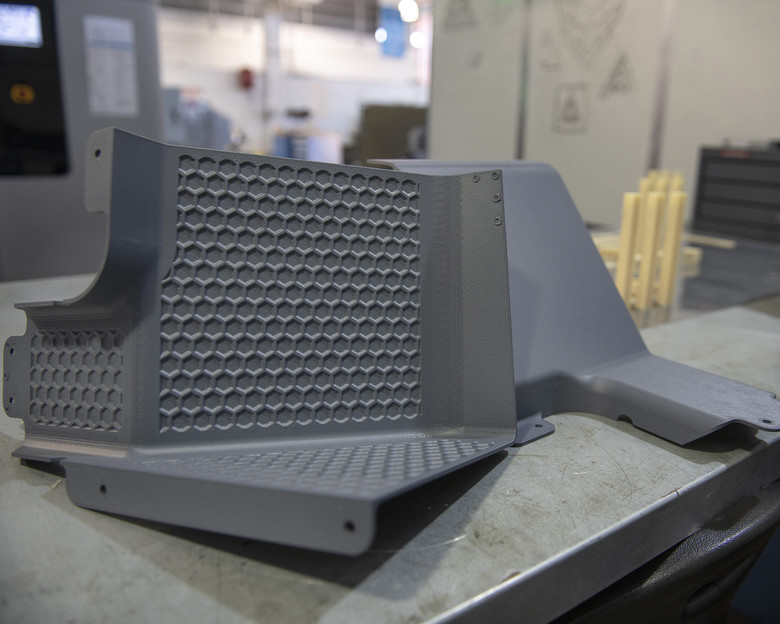 Latrine covers, the first aircraft parts authorized for use after being printed on the Stratasys F900. Photo via U.S. Air Force/Louis Briscese.