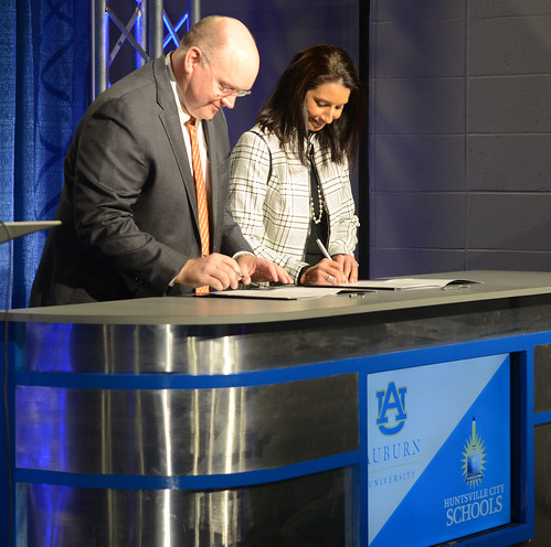 Auburn engineering dean Christopher B. Roberts signs the memorandum of understanding with Huntsville City Schools superintendent Christie Finley. Photo via Auburn University.