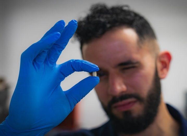 Evert Feunmayor with the 3D printed pill. Photo via Athlone Institute of Technology.