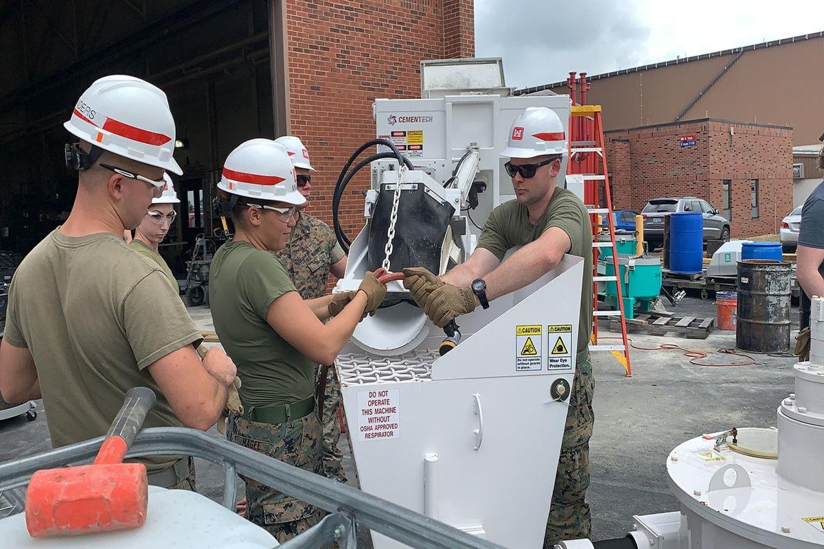 The U.S Marine teams setting up the concrete 3D printer. Photo via U.S. Marines/Staff Sgt. Michael Smith, 7th ESB