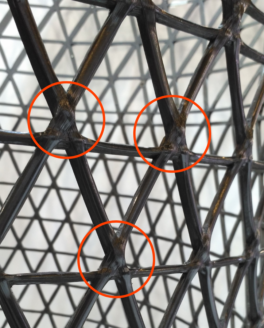 A prepreg-based lattice showing the rise in thickness in the places of intersections. Photo via Anisoprint.