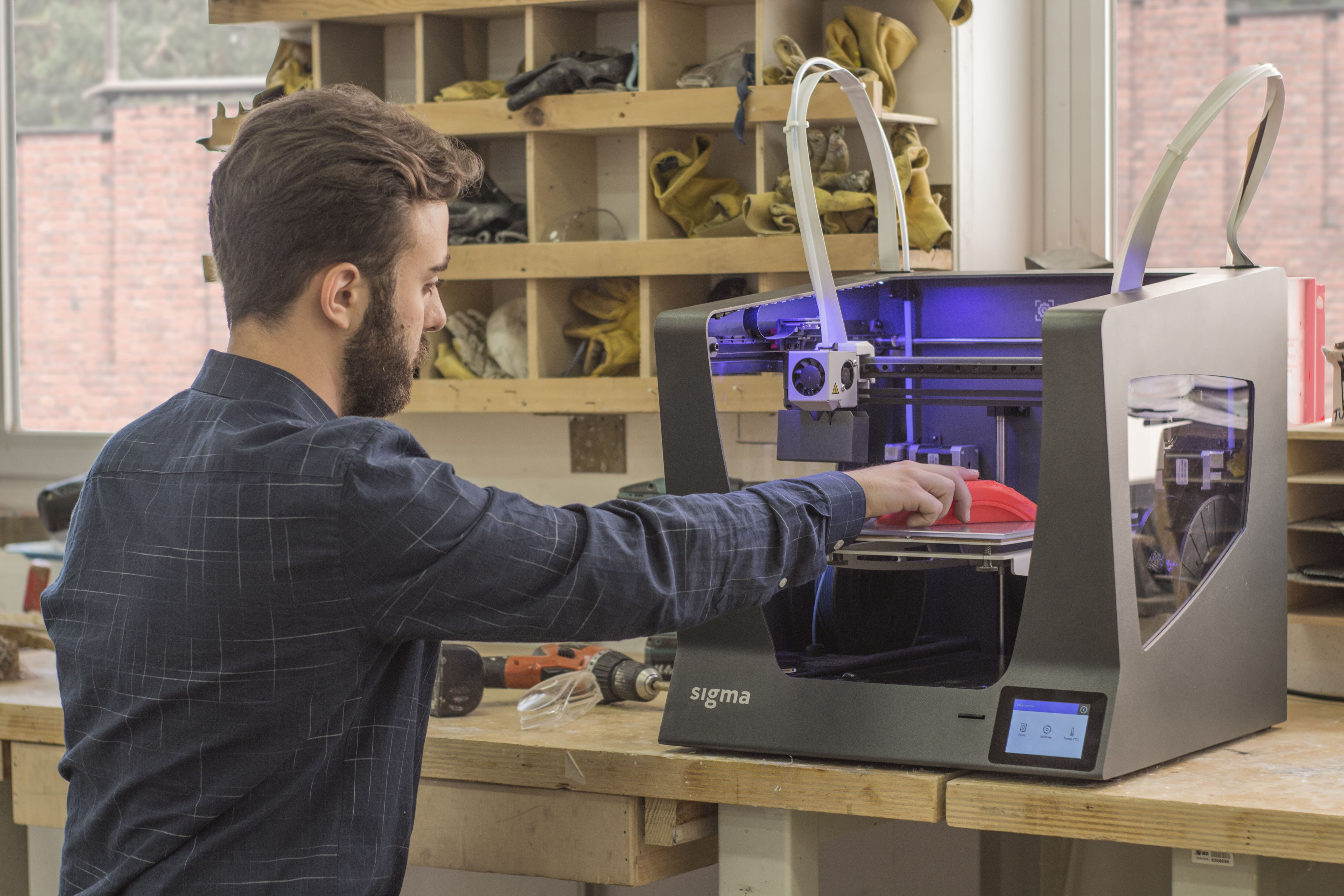 A student at IED Barcelona using the Sigma 3D printer. Photo via BCN3D Technologies.