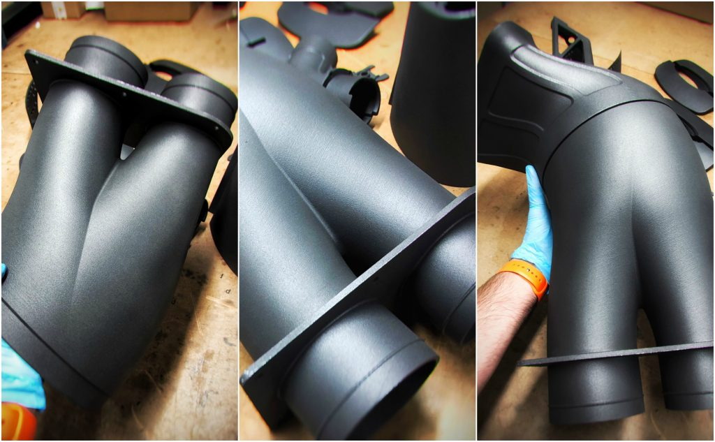 3D printed duct fitting for the Bloodhound LSR, showing detail of smooth surface finish. Photos via Graphite AM