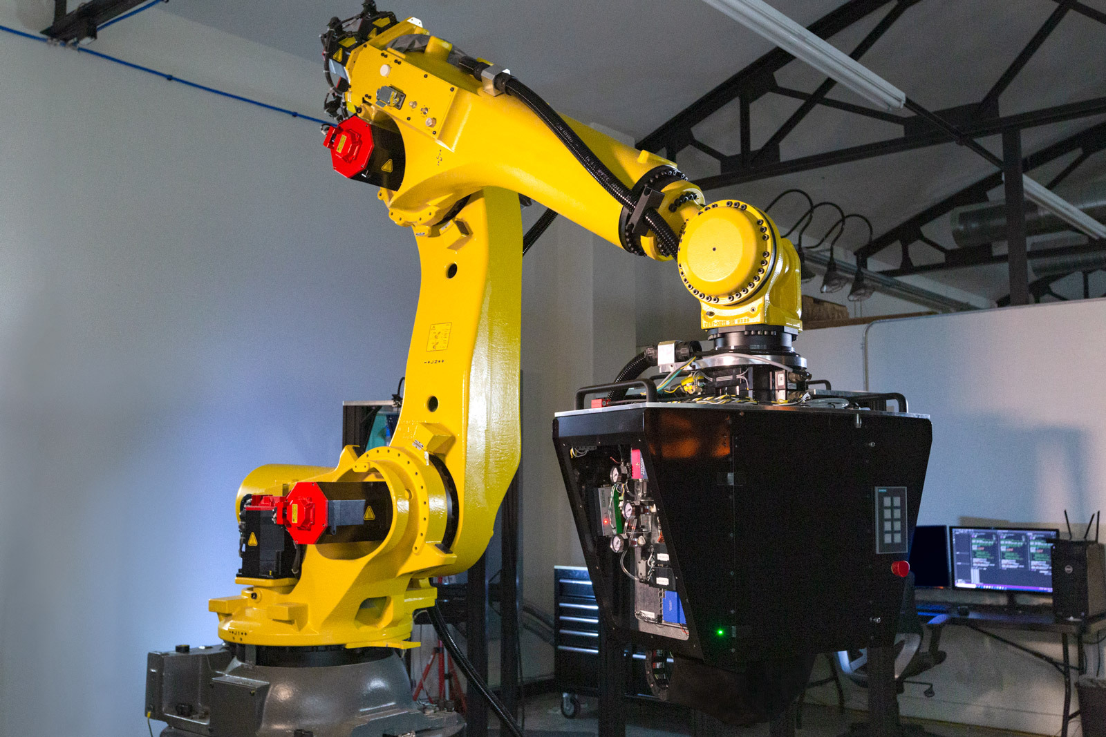 The patented CF3D process uses a robot arm. Photo via Continuous Composites.