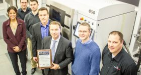 The Precision ADM team celebrate their AS9100 /ISO9001 certification. Photo via Precision ADM