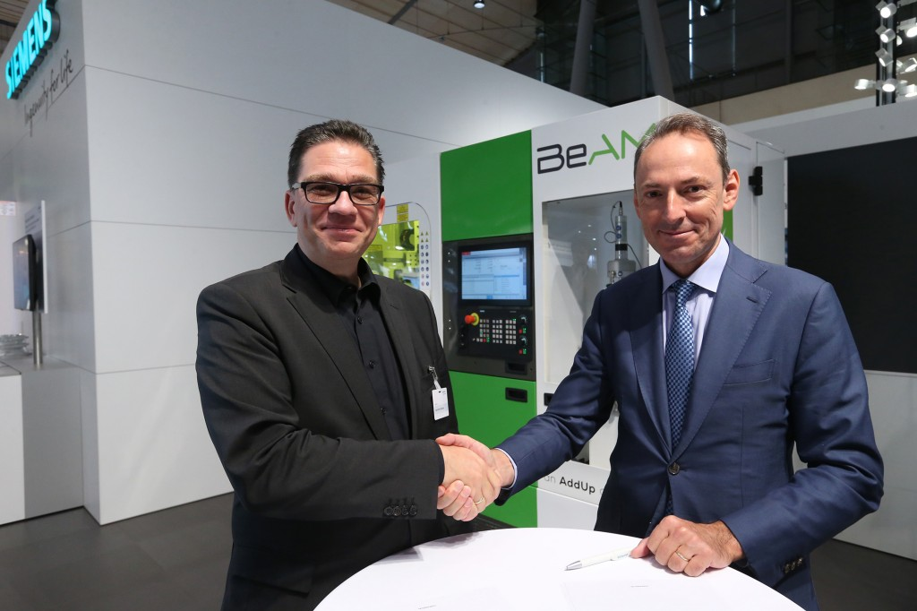 From left: Uwe Ruttkamp, Head of Machine Tool Systems at Siemens Digital Industries and Vincent Gillet, CEO of BeAM. Photo via Siemens.