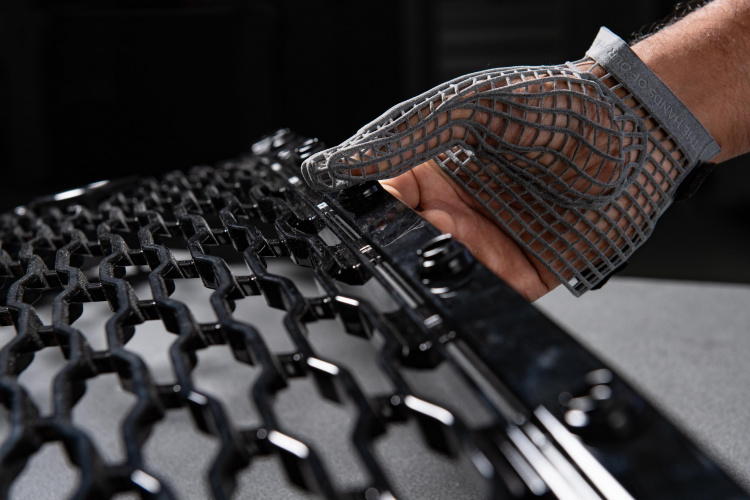 The 3D printed glove used to handle parts on the production line. Photo via Jaguar Land Rover.