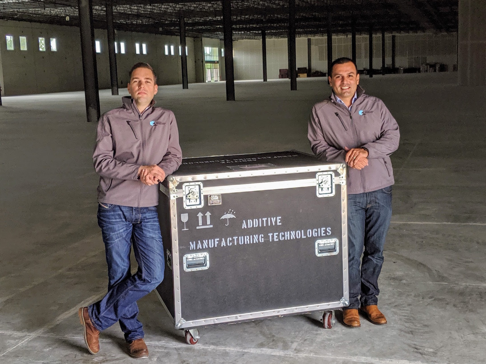 From left: Joseph Crabtree, CEO and Luis Folgar, EVP Americas in the new AMT facility in Austin, Texas. Photo via Additive Manufacturing certification Technologies.