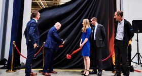 Dr. Simon Weeks, CTO of the Aerospace Technology Institute (ATI) cuts the ribbon on the MTC's new metal additive manufacturing innovation hub. Photo via The MTC