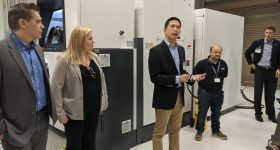 Quan Lac, Head of Additive Manufacturing Americas for Siemens Gas & Power, giving an overview of Materials Solutions' U.S.-based EOS M400-4. Photo by Dayton Horvath for 3D Printing Industry