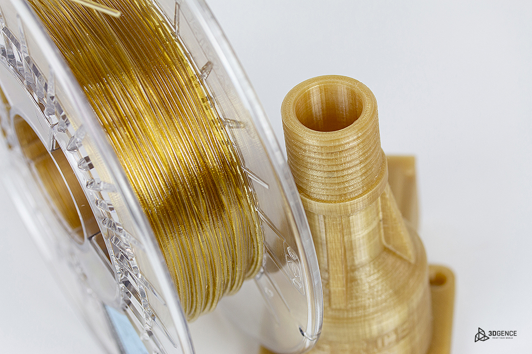 Close up of PEKK-A filament next to 3D printed PEKK-A object. Photo via 3DGence.