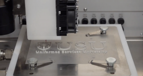 The Uniformed Services University of the Health Sciences (USU) logo 3D printed on a bioprinter. Screenshot via Uniformed Services University