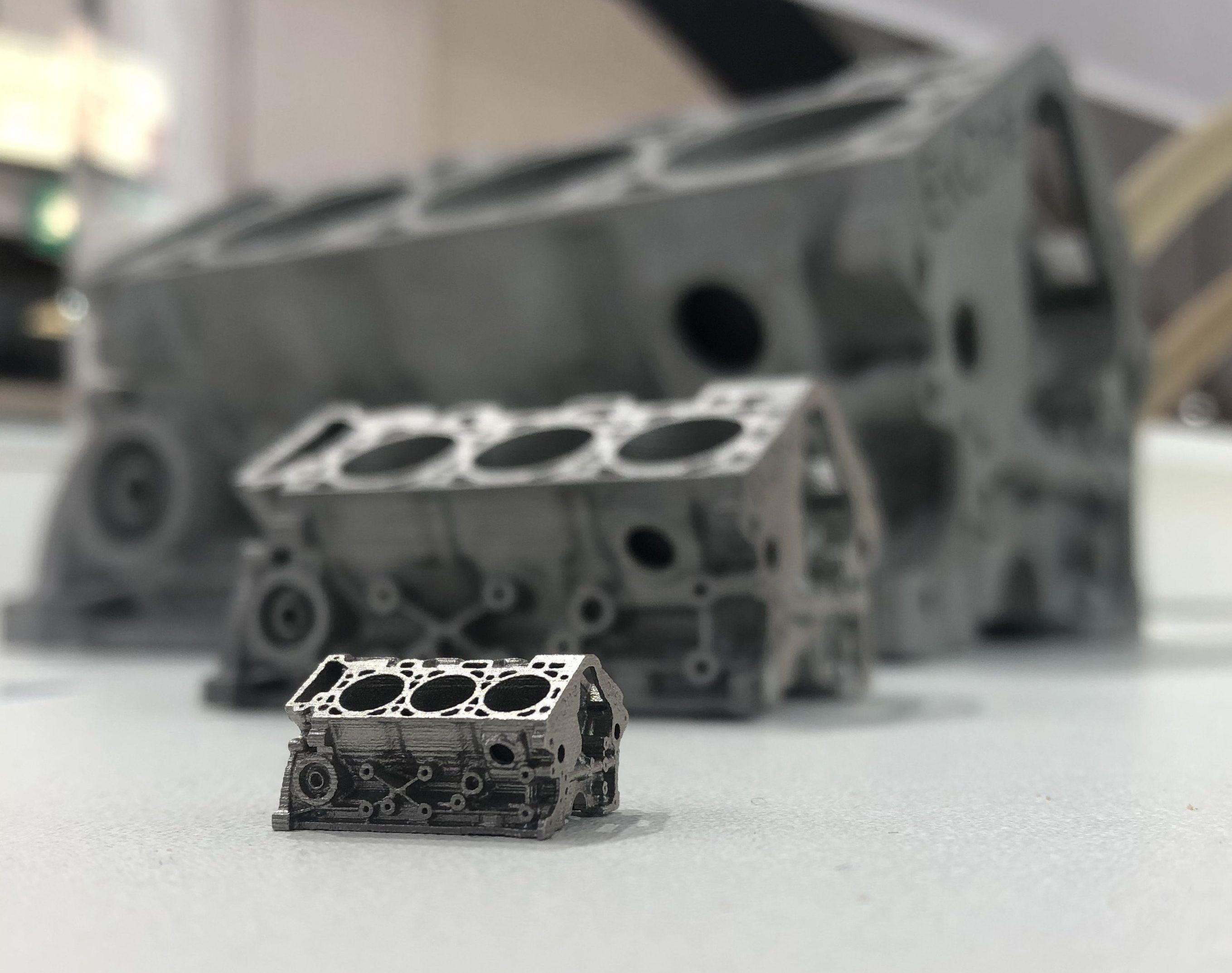 3D printed metal engine blocks. Photo via ExOne.