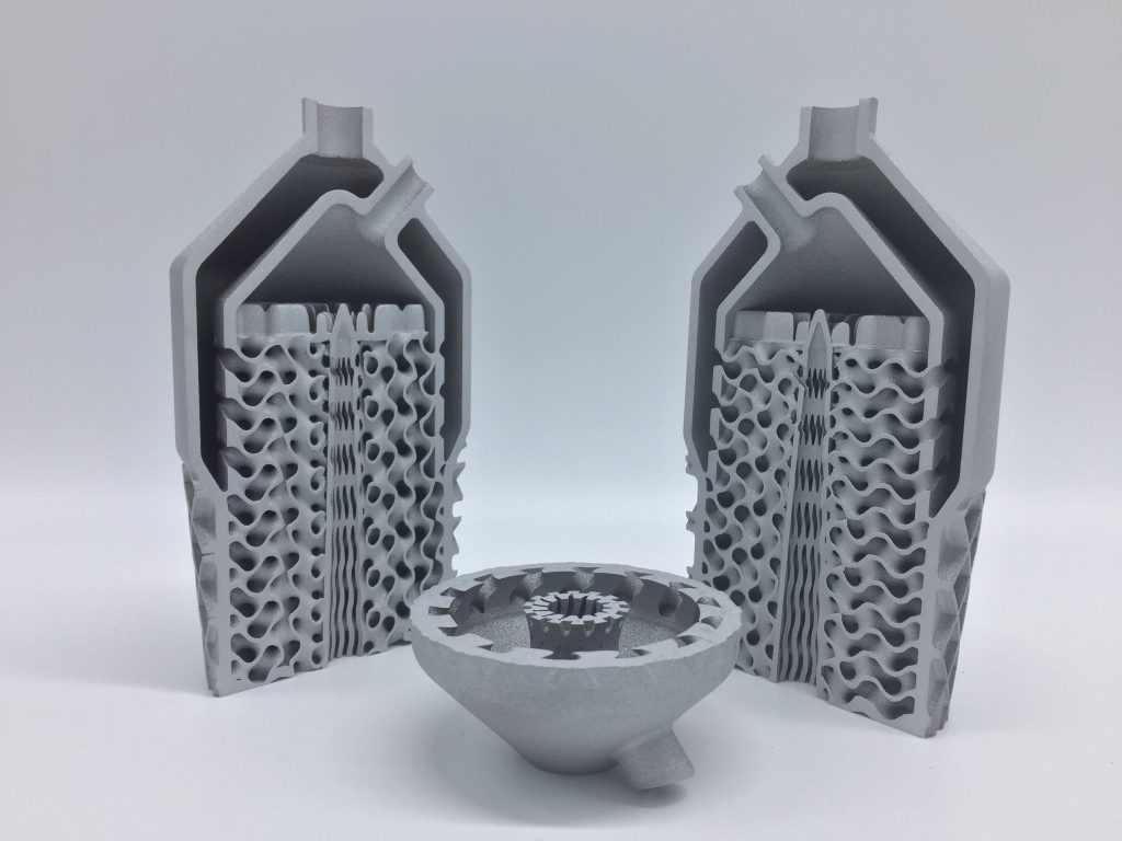 The final topological gyroid heat exchanger design, 3D printed as a cutaway to show internal geometries. Photo via HRL Laboratories and Morf3D