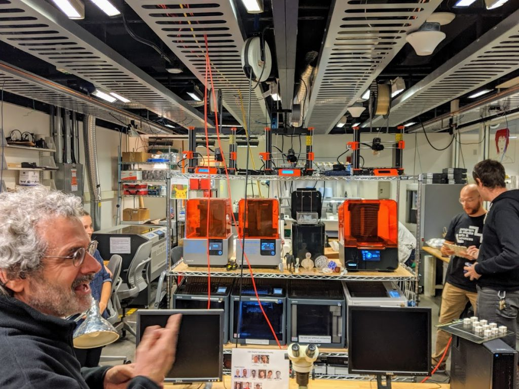 Neil Gershenfeld at MIT's Center for Bits and Atoms and several Formlabs 3D printers. Photo by Michael Petch.