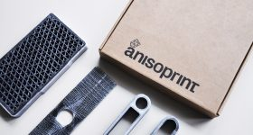 Continuous fiber reinforced parts anisoprinted on Anisoprint Composer 3D printer. Photo via Anisoprint