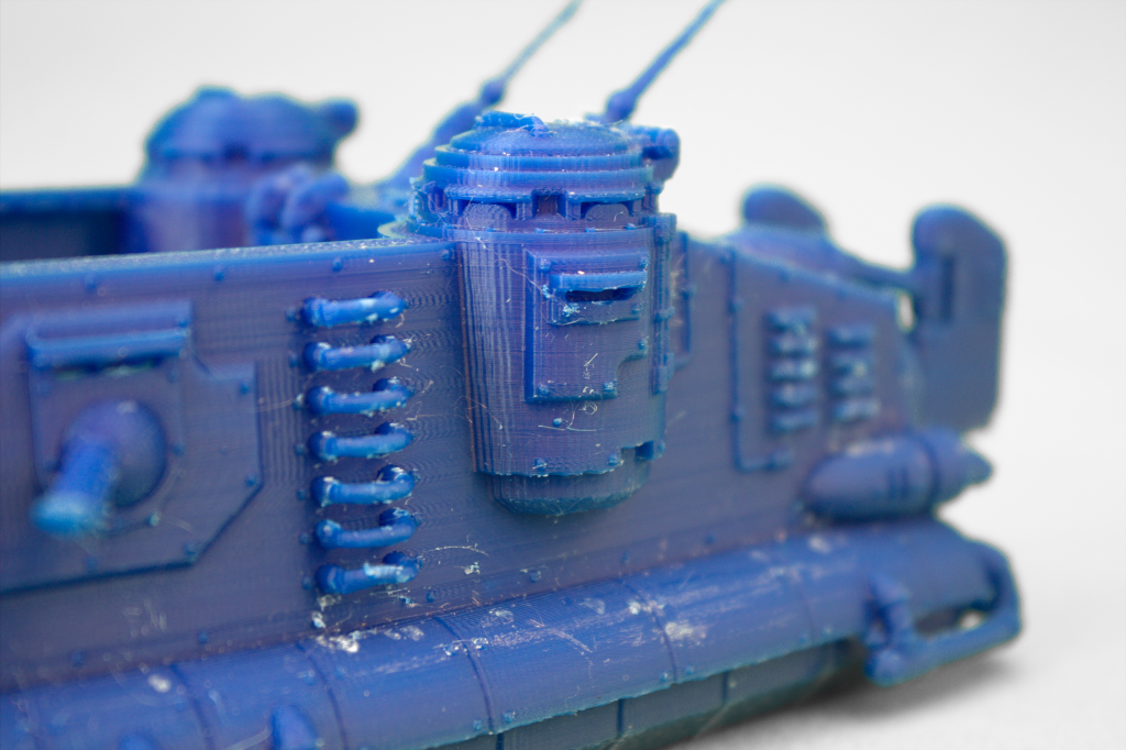 A detailed tank model as-printed has a few surface defects that can easily be removed using a scalpel and grit paper.