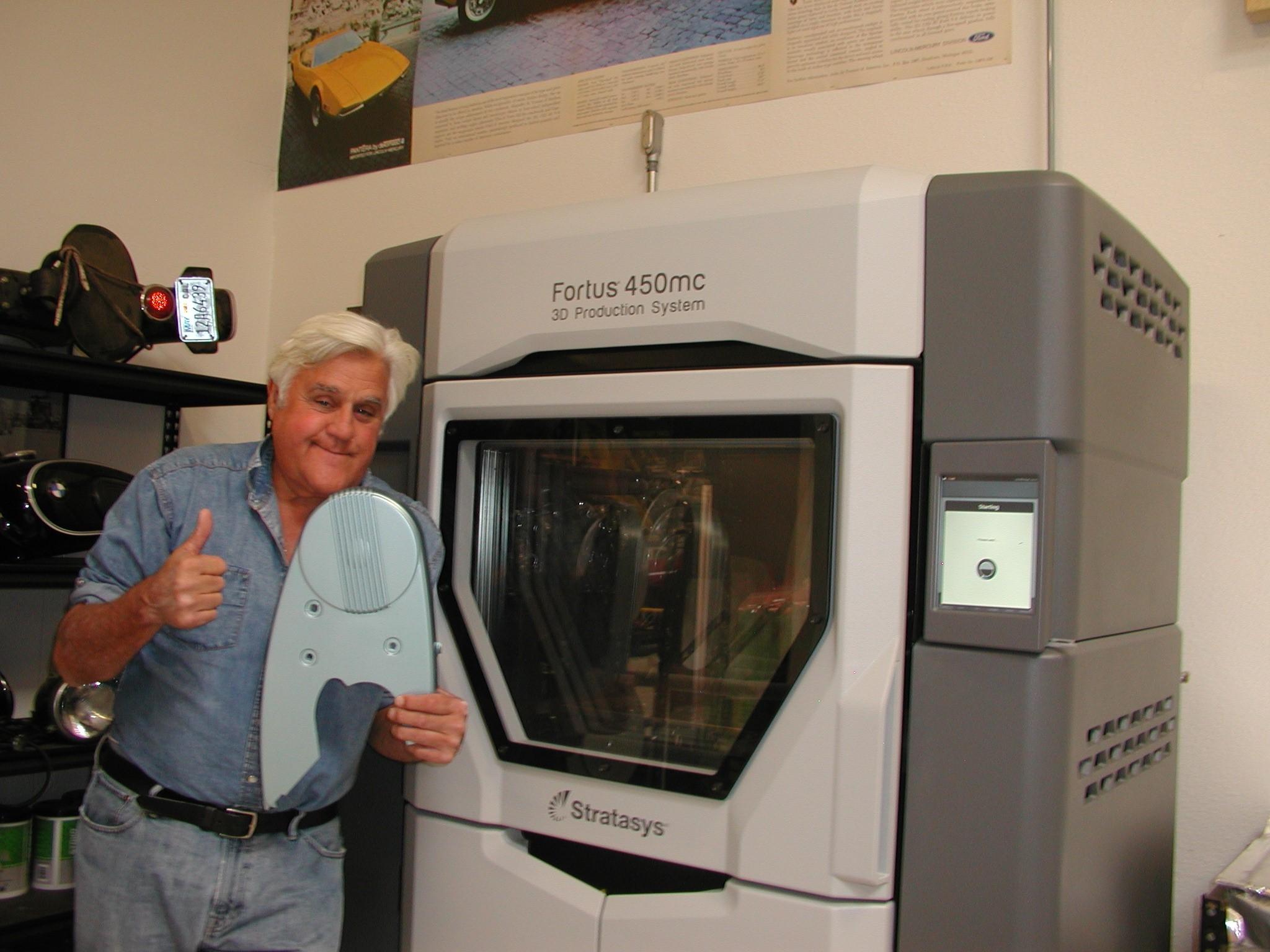 Jay Leno next to Stratasys Fortus 450mc 3D printer. Photo via Stratasys.