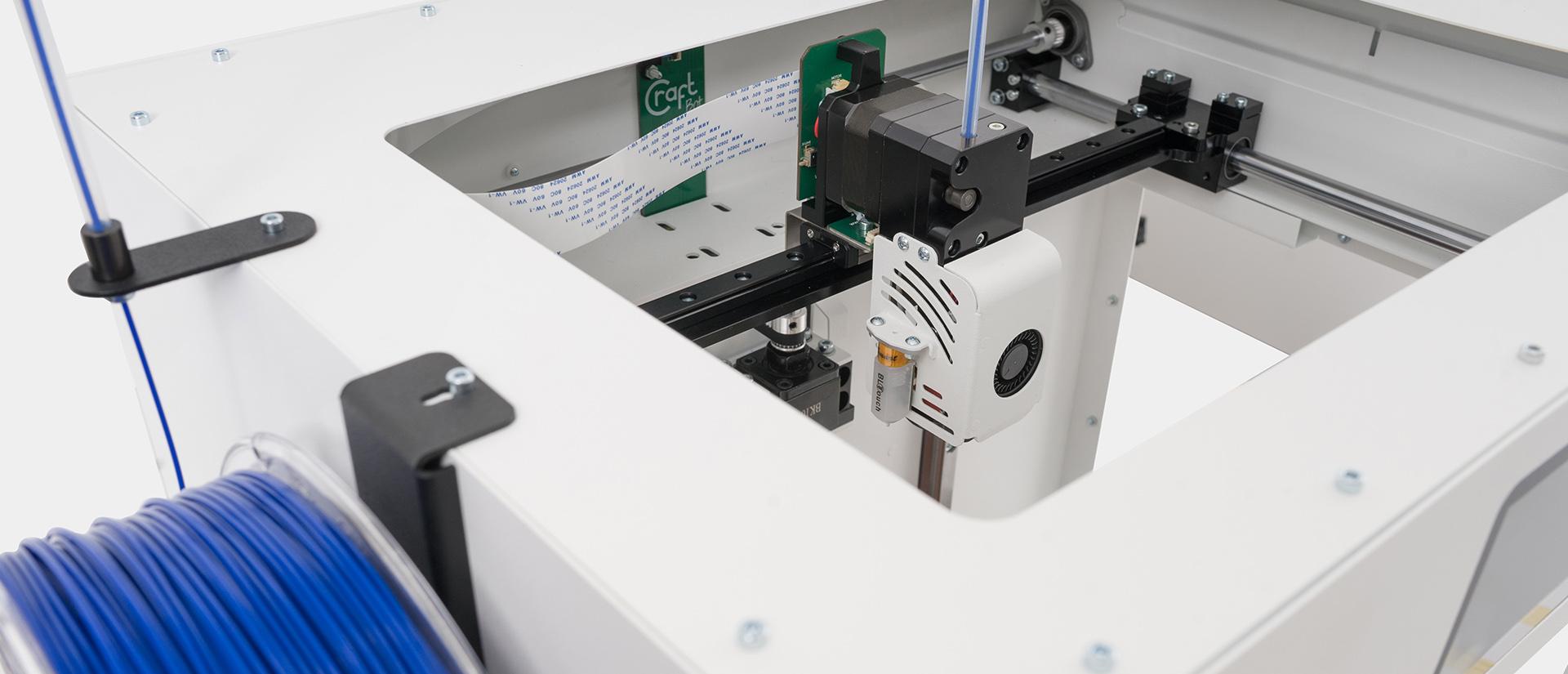 Inside the single extruder CraftBot Flow 3D printer. Photo via CraftUnique.