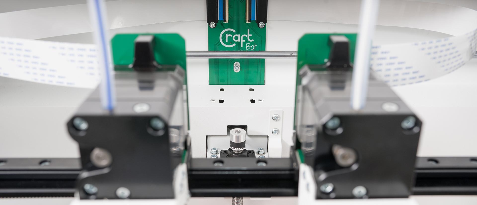 Inside the dual extruder CraftBot Flow IDEX 3D printer. Photo via CraftUnique.