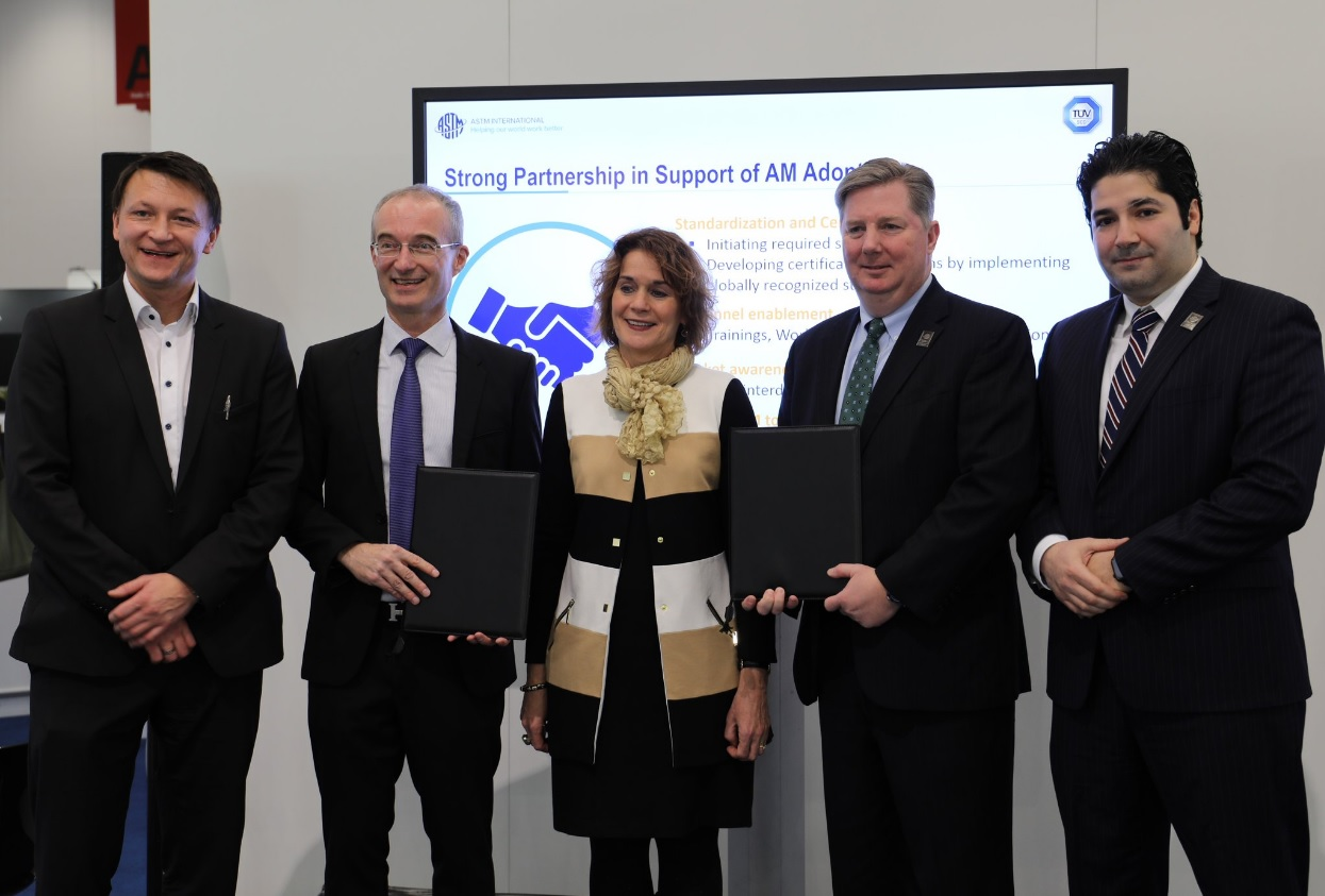 From left: Gregor Reischle, Head of Additive Maufacturing at TÜV SÜD, Holger Lindner, CEO Product Service at TÜV SÜD, Patricia Lacina, Consul General at the U.S. Consulate in Frankfurt, Leonard F. Morrissey, Director of Global Business Development and Strategy at ASTM International, Dr. Mohsen Seifi, Director of Global <a href=