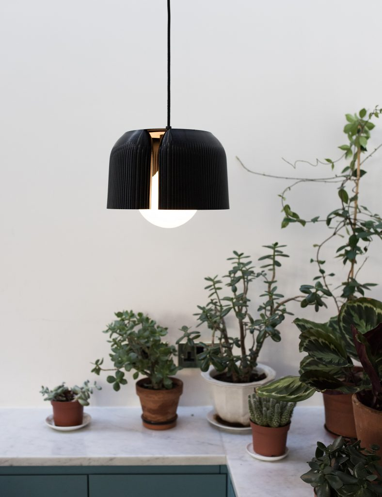 A Ribbon Black lamp shade 3D printed by Batch.works for Plumen as part of the new sustainable range. Photo via Plumen