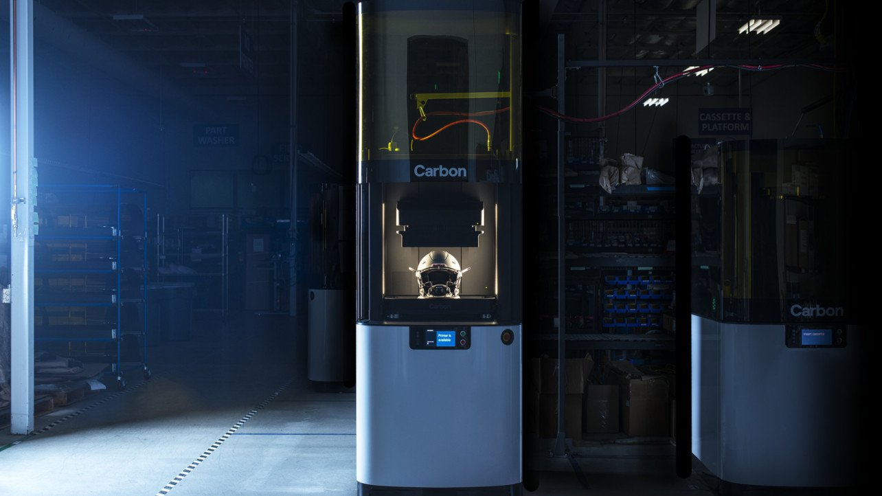 The Diamond Helmet inside the L1 3D printer. Photo via Carbon.