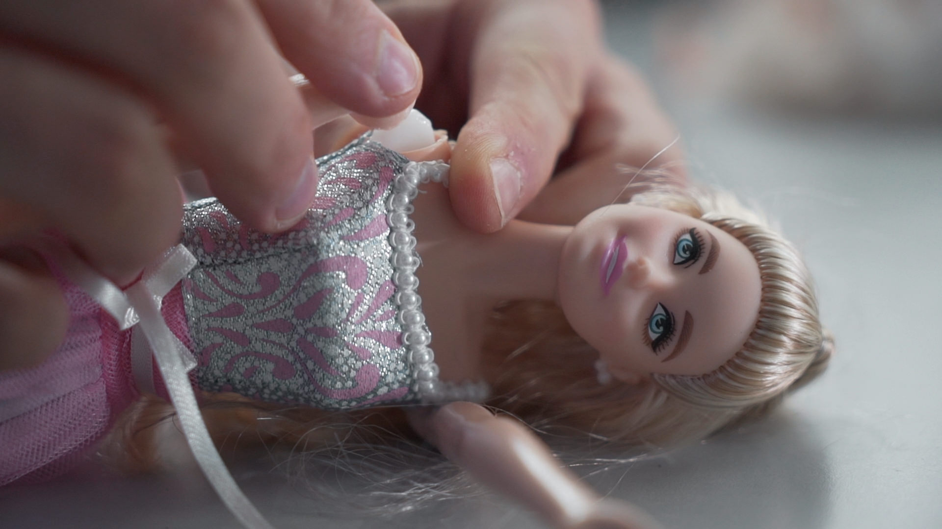 Fixing Barbie with 3D printed part. Photo via Dagoma.