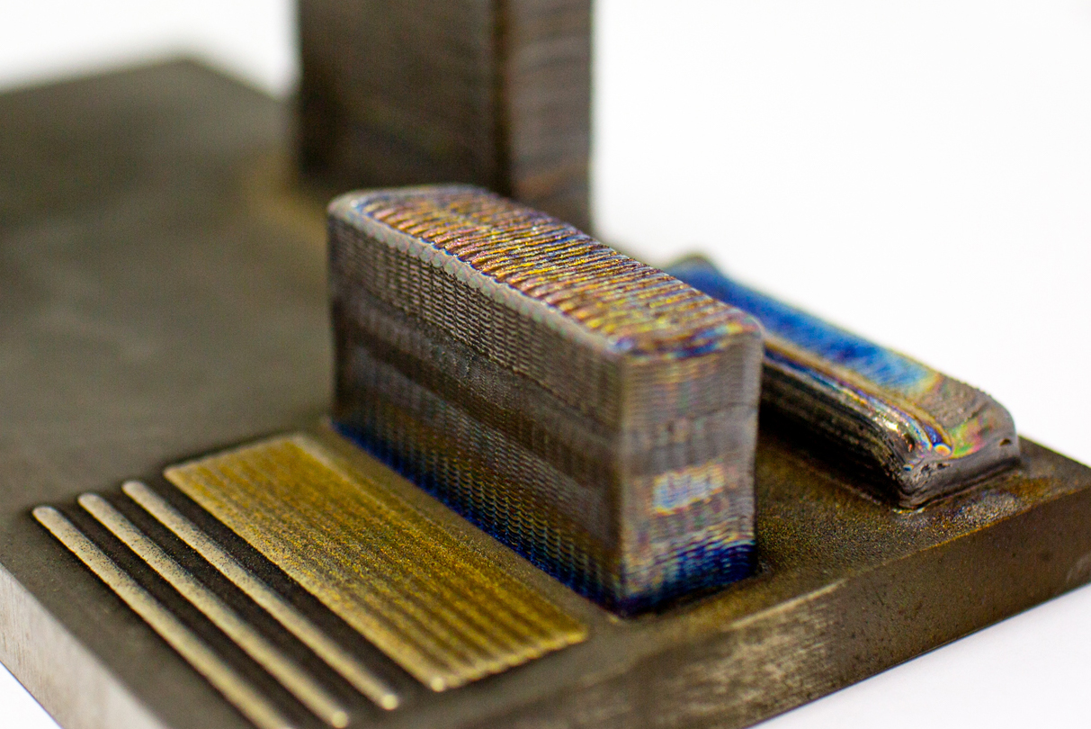 A 3D-printed titanium-copper block made at RMIT's Advanced Manufacturing Precinct. Photo via RMIT.