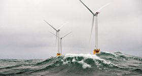 """Heavy seas engulf the Block Island Wind Farm- the first US offshore wind farm. The five Halide 6MW turbines were installed by Deepwater Wind and began producing power in 2016."" Photo by Dennis Schroeder / NREL"
