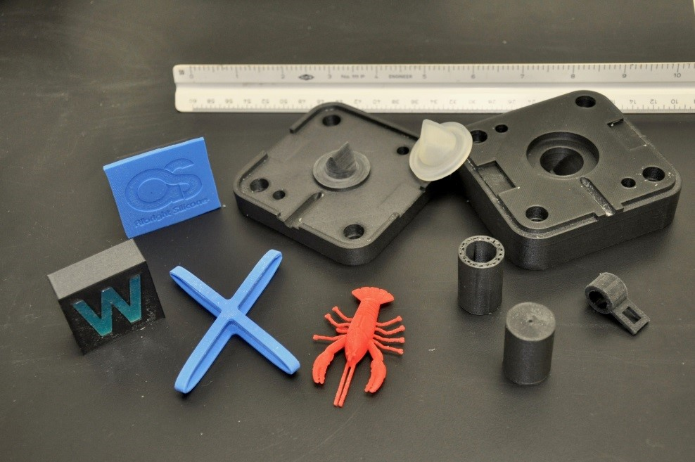 Silicone parts alongside 3D printed molds. Photo via Albright Silicone.