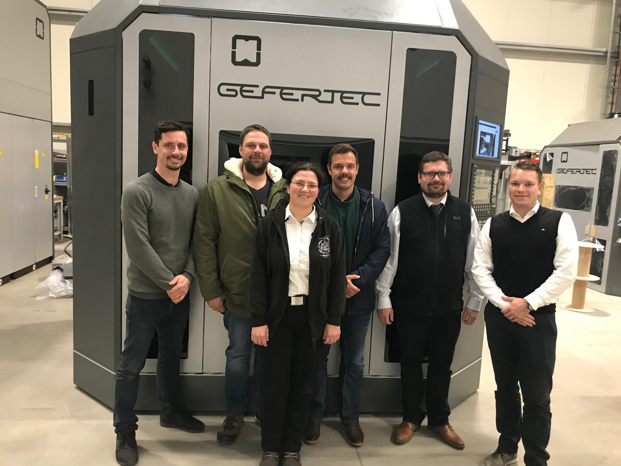 Dr. Roman Herzig (2nd from right) at GEFERTEC in Berlin for pre-approval of the new arc403. Photo via GEFERTEC.