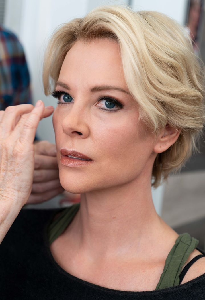 Theron spent three hours in the chair transforming into Kelly. Photo via www.huffingtonpost.co.uk