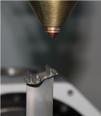 Automated laser cladding process. Image via Optomec.