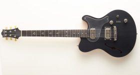 The guitar with 3D printed amorphous metal bridge. Photo via Heraeus.