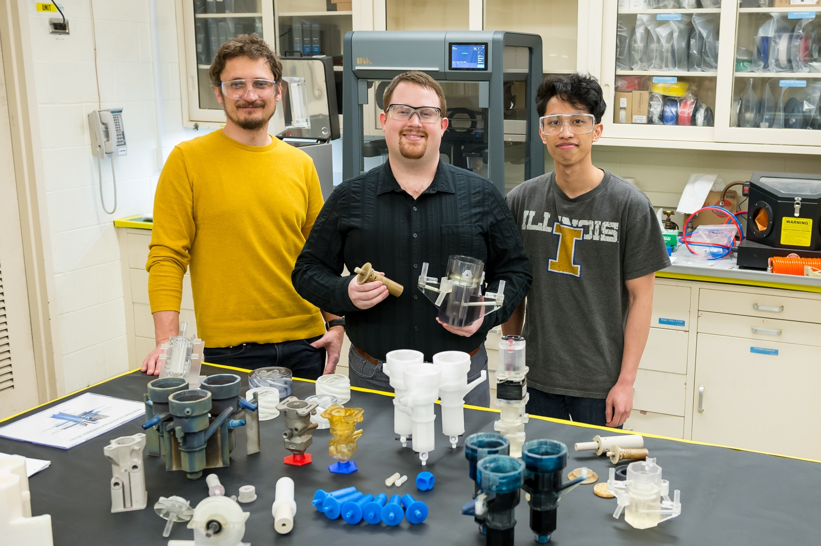 The Argonne research team with their 3D printed contactors. Photo via Argonne National Laboratory.